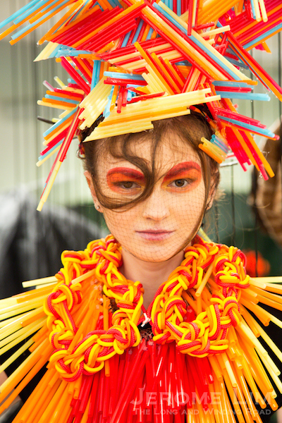 A model dressed in Shunji Matsuo's happy colours at the opening of the exhibition on Friday.