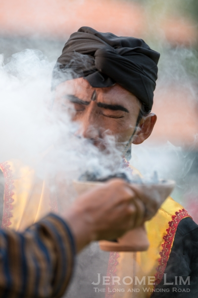 Smoke from the kemenyan (incense) being breathed in.