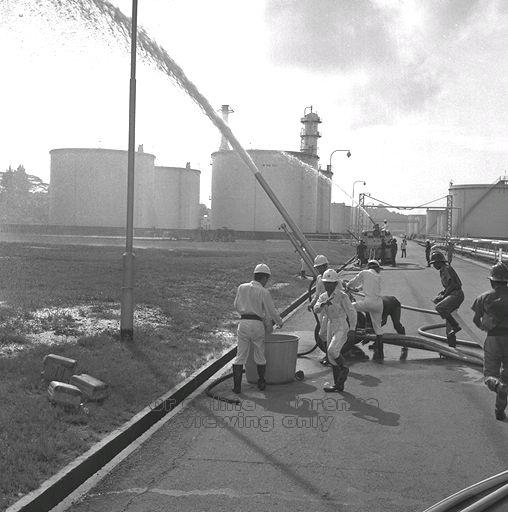 A fire-fighting exercise at the BP Refinery in 1968 (source: National Archives of Singapore).