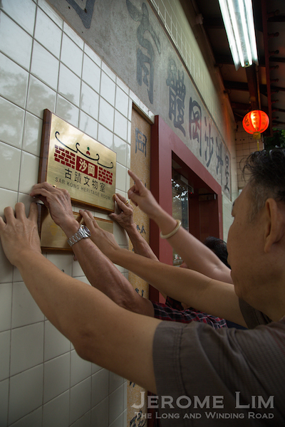 Putting up the plaques.