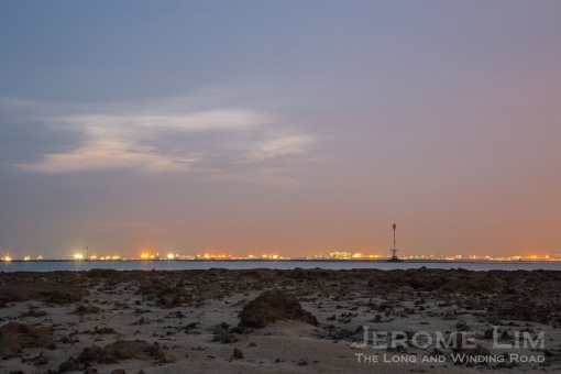 The sky at twilight from Beting Pempang, coloured by the advancing petrochemical plants that now dominate much of the southwestern shores.