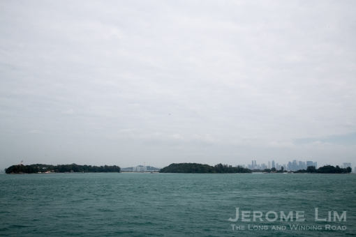 The cluster of islands at which Raffles first made contact with Singapore, with the Singapore he helped create in the background. St. John's Island is on the left with Lazarus Island and Kusu next to it.