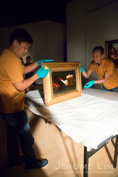 Unwrapping the painting.