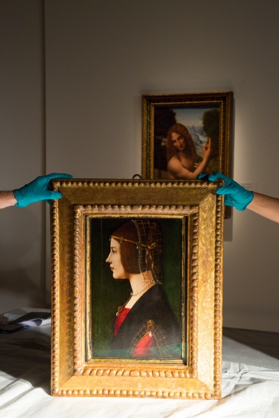 The painting, seen with one of the paintings that has been taken down for storage, Saiai's St. John the Baptist.