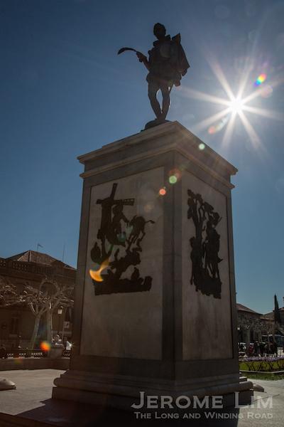 The statue of Cervantes in the centre of Plaza de Cervantes.