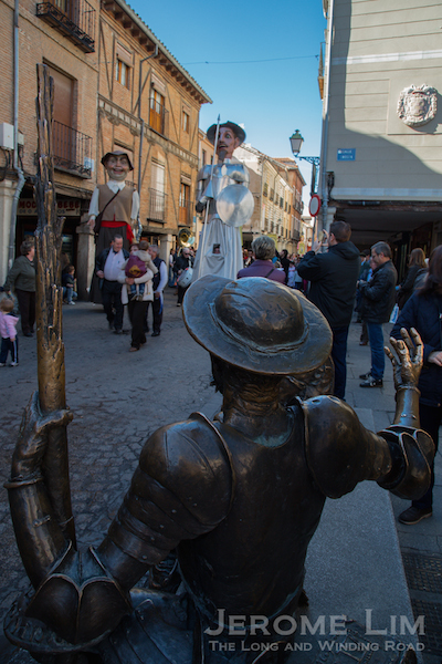 Don Quixote meets the procession along Calle Mayor.