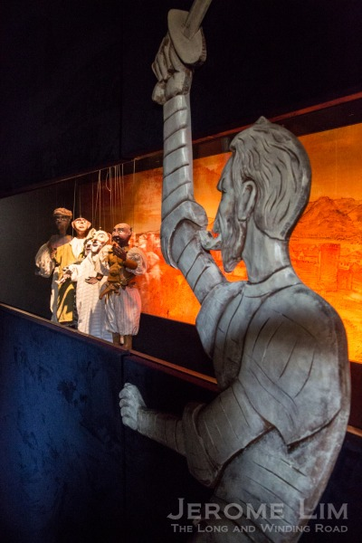 An exhibit depicting a scene from a puppet play at the birthplace of Cervantes.