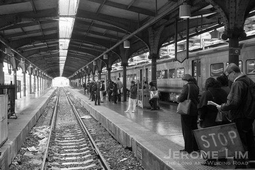 Passengers waiting at commuter train platform at the terminal.