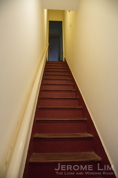 The narrow stairway up to the bedrooms intended for the service staff.