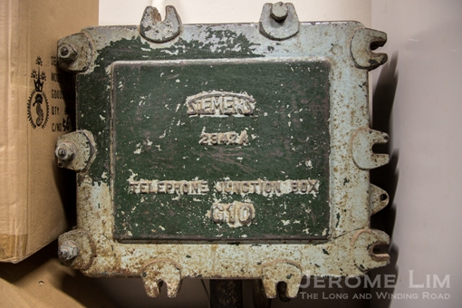 An old telephone junction box inside the house.