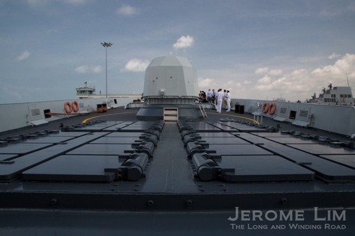 The HQ-16 SAM vertical launcher cells on the fore deck.