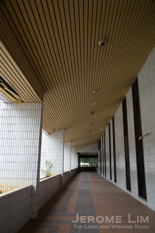 The upper floor corridor overlooking the swimming pool.
