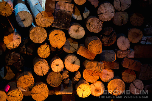 Wood for firing in the glow of the kiln.
