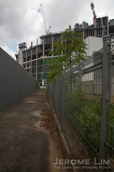 The first break in the continuity of the former corridor where a ramp-up logistics facility is being built just across the former crossing at Tanjong Kling Road.
