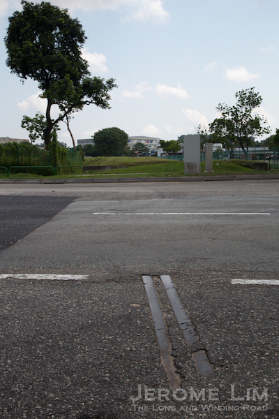 Tracks of the former level crossing are in evidence at Jurong Port Road.