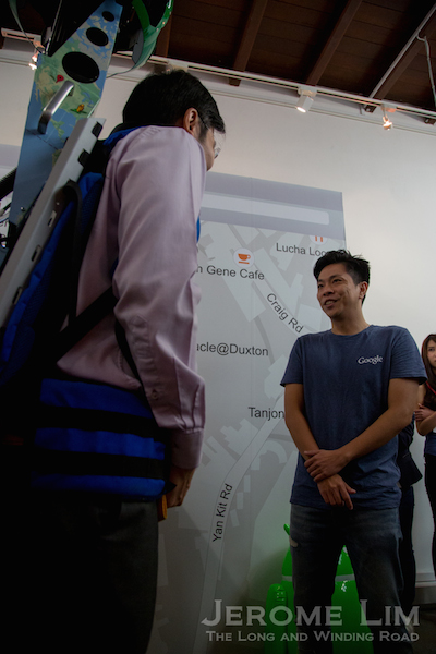 The man behind the Google Trekker and the off-the-beaten-track street views of Singapore, speaking to Minister Lawrence Wong.
