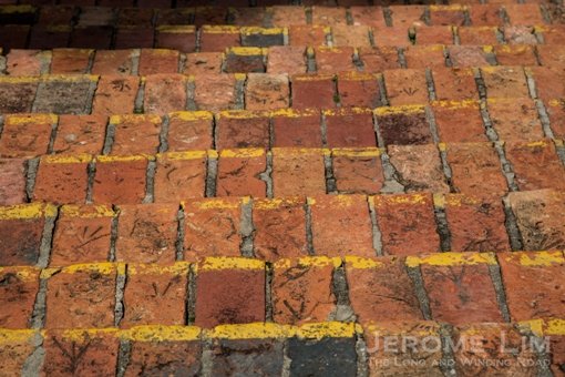 A close-up of the bricks used to make the steps - with arrows seen on some of them.