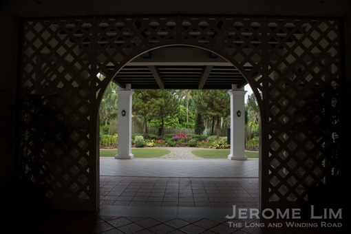 The National Orchid Garden seen through the porch of Burkill Hall.