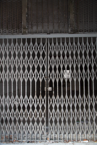 The now closed gates of the shop the noodle manufacturer once occupied.