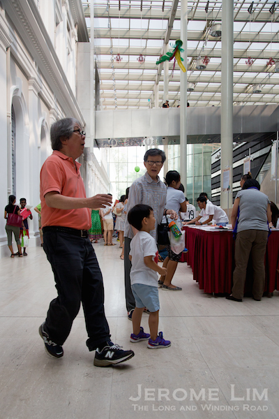 Prof. Tommy Koh showing his Chapteh skills at the Opening Weekend Carnival.