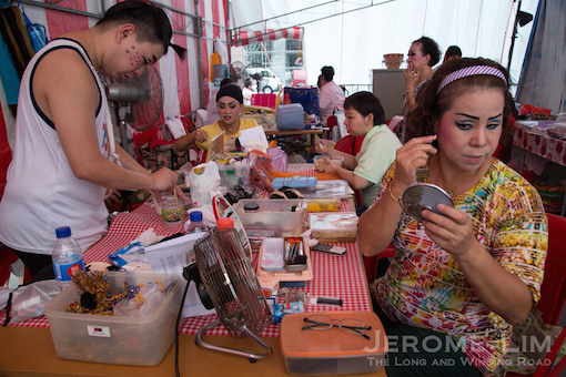 The back stage area is abuzz with preparation activity before each performance.