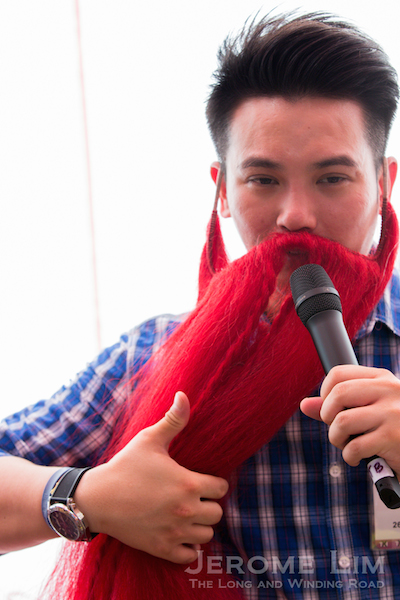 Nick Shen doing a demonstration of an actor's beard is sometimes moved on stage.