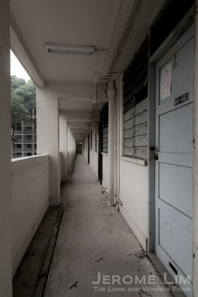 The common corridor - the slot in the original door found on many of the vacated flats were for mail - a reminder of when the postman used to deliver mail door to door.