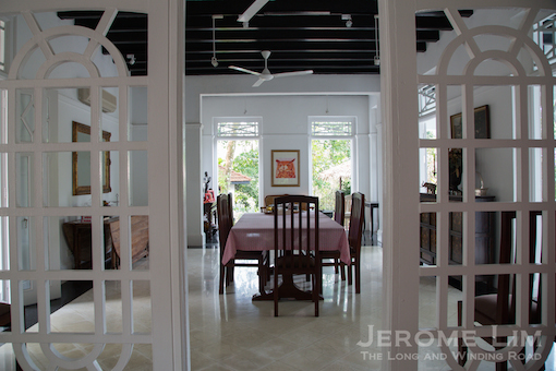 The dining room on the ground level, as seen from the entrance hallway.