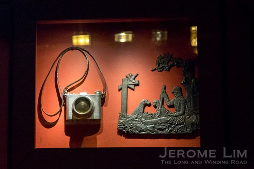 A camera shaped flask in the collection.