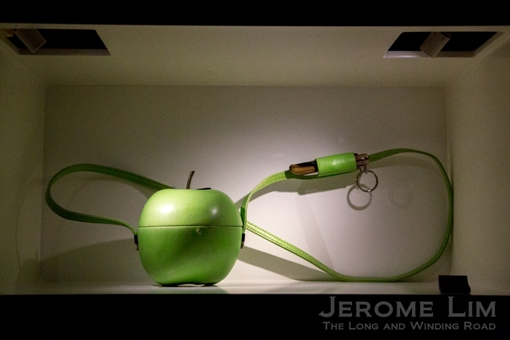 An apple carrier (complete with knife and holder) on loan from its owner who commissioned it to allow him to carry his apple a day.