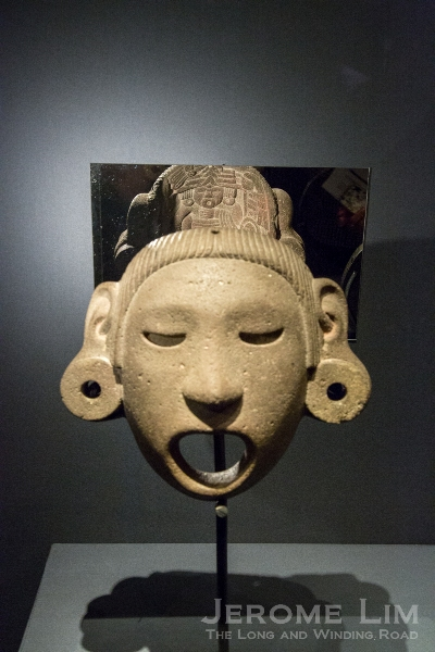 Deity mask. Mexico. Aztec (Mexica), around AD 1400–1521. Grey volcanic stone. (The reflection shows the carved inside surface).