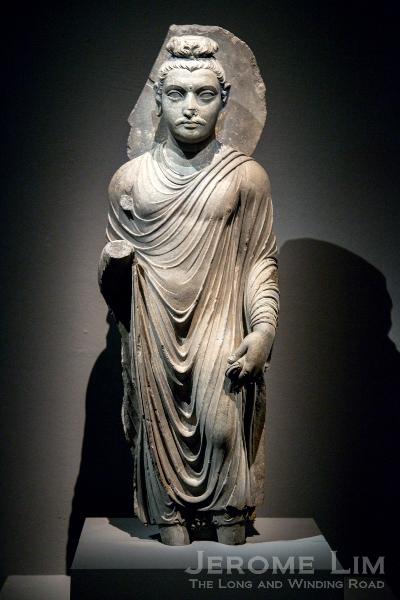 Standing figure of the Buddha. Ancient Gandhara, Pakistan. AD 100–200. Grey schist.