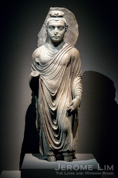Standing figure of the Buddha. Ancient Gandhara, Pakistan. AD 100–200. Grey schist.