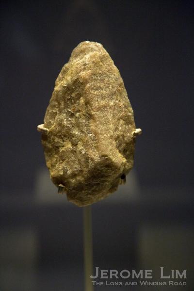 Stone handaxe. Olduvai Gorge, Tanzania. Lower Palaeolithic, about 800,000 years old. Quartzite.