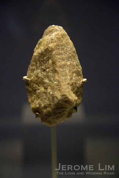 Stone handaxe. Olduvai Gorge, Tanzania. Lower Palaeolithic, about 800,000 years old. Quartzite.