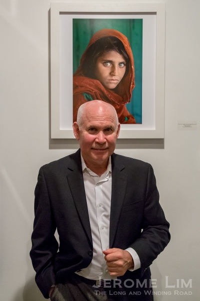 Steve McCurry in Singapore with the Afghan Girl.