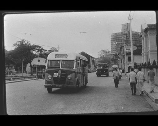 A Bras Basah still with its many reminders of the past. The Cox Club at Waterloo Street can be seen on the left behind the bus (F W York Collection, National Archives of Singapore).