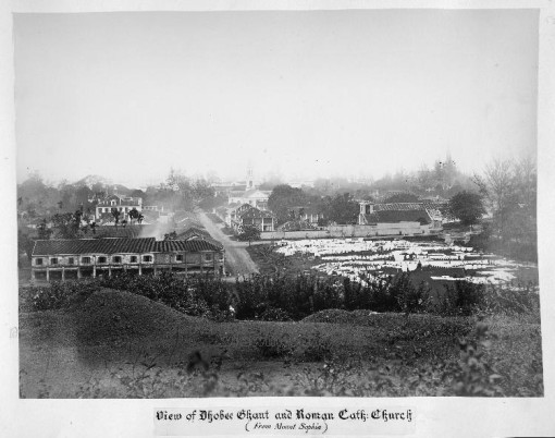 A view of Bras Basah Road from Mount Sophia on a 19th century postcard The gaol is seen just beyond the drying laundry at Bras Basah Green - what gave Dhoby Ghaut its name.