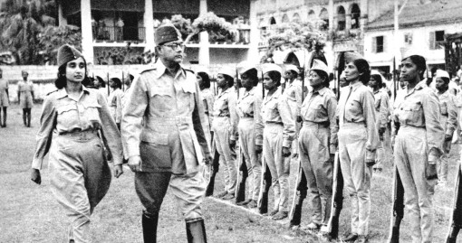 Capt. Lakshmi and Subhas Chandra Bose inspecting the members of the INA Rani of Jhansi regiment at the camp in Bras Basah Road. The former apothecary building and the arched verandahs of what became the Soon Choon Leong building at the corner of Bras Basah Road and Bencoolen Street can quite clearly be seen.