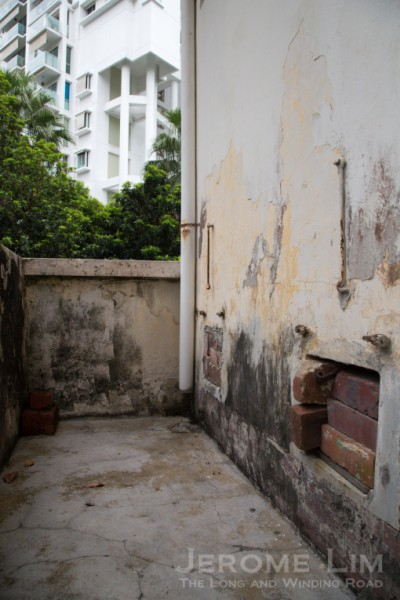 The back of a WC on the upper level of an auxiliary building - with openings once used for the collection of 'honey-pots'.