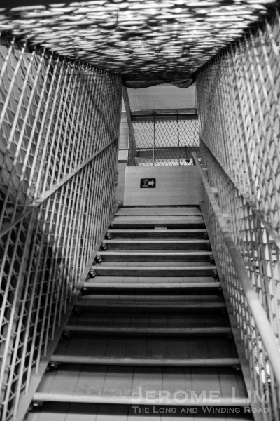 A caged stairway.