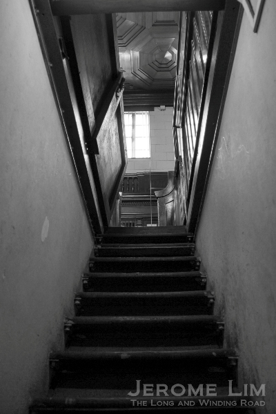 The stairway up to a courtroom, entry to which was through a trapdoor (which can still be seen in their closed positions).