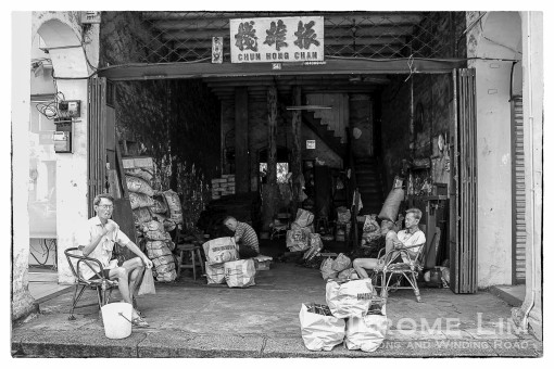 The charcoal shop -this one seen in Ipoh in 2010, was once a common sight in Singapore.
