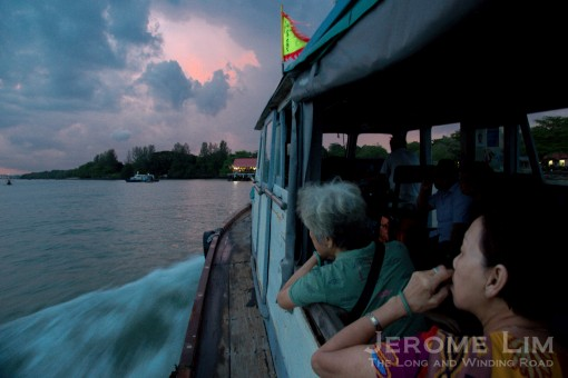 A boat load of devotees heading to Pulau Ubin.