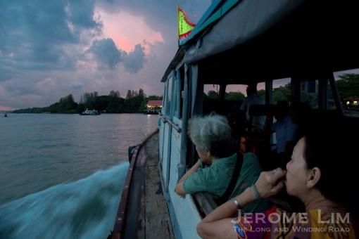 A boat load of devotees heading to Pulau Ubin.