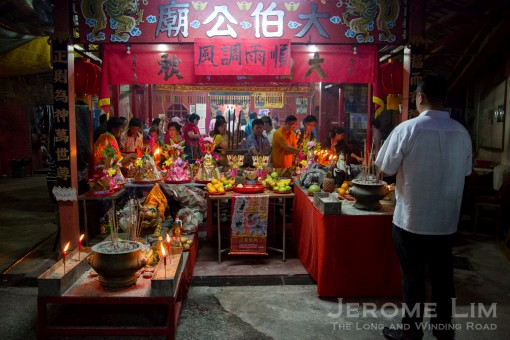 The lower temple saw a steady stream of devotees making offerings.