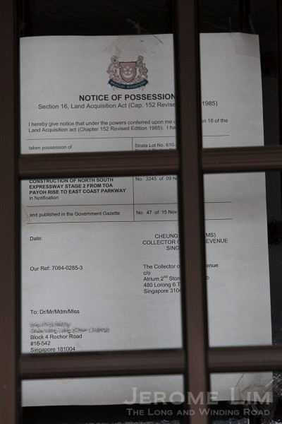 Possession Notice pasted on the door of a residential unit.