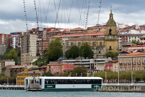 The suspended gondola of the Vizcaya Bridge with Portugalete seen in the background.