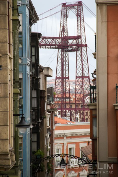 The Vizcaya Bridge seen through the buildings of Portugalete.