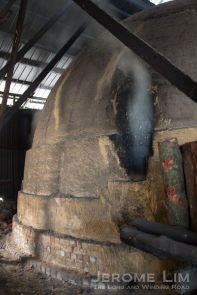 Vapour coming out of a kiln - the vapour, which is used to monitor the process , is collected and sold in its condense form as mangrove wood vinegar.